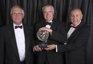 Phil George and John Roberts receiving the award from Carwyn Jones (Photo: BAFTA Cymru / Huw John)
